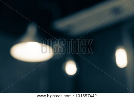 Defocused  Blur Abstract Of Lamp In Coffee Shop Background