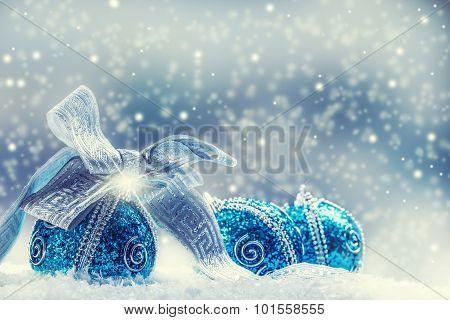 Christmas.Christmas blue balls and silver ribbon snow