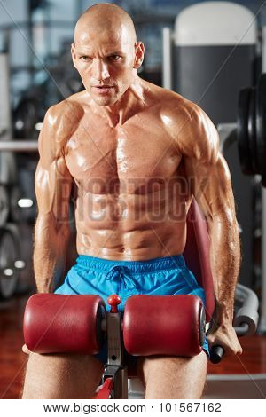 Athletic man doing triceps and chest workout at press in the gym poster