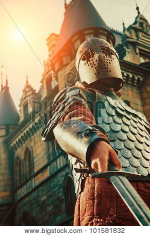 Medieval Knight With The Sword On The Ancient Castle Background