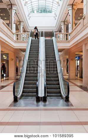 KIEV, UKRAINE - SEPTEMBER 14, 2015: Panoramic angle of escalator. Escalator at shopping mall or trad