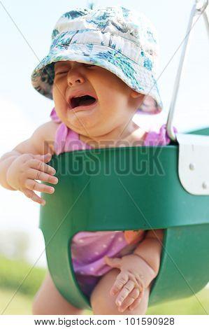 Baby Girl Crying In Toddler Swing