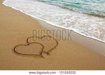 Two Love Hearts on Sand.