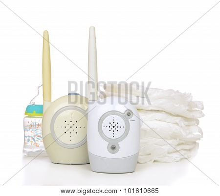 Child Baby Kid Radio Monitor Device Stack Of Diapers With Baby Feeding Bottle Water