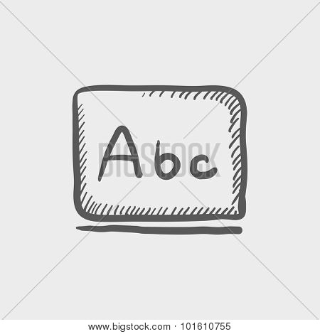 Letters abc on the blackboard sketch icon for web, mobile and infographics. Hand drawn vector dark grey icon isolated on light grey background.