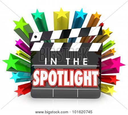 In the Spotlight words on a movie clapper board to illustrate recognition or appreciation for a special person with an award or profile