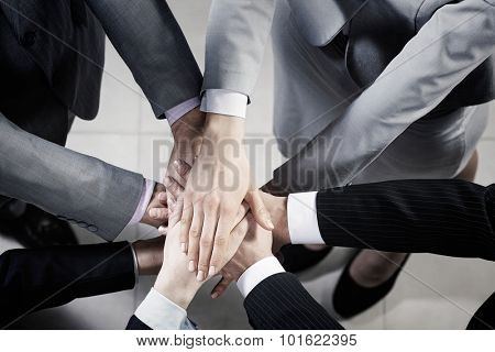 Top view of many businesspeople with hands joined in stack poster
