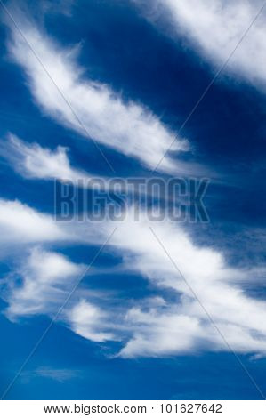 Scenic Stratus Clouds Against Deep Blue Sky