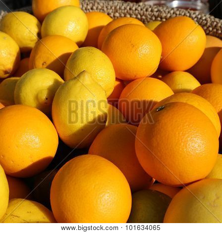 Orange And Yellow Sicilian Lemons For Sale In Greengrocers Shop