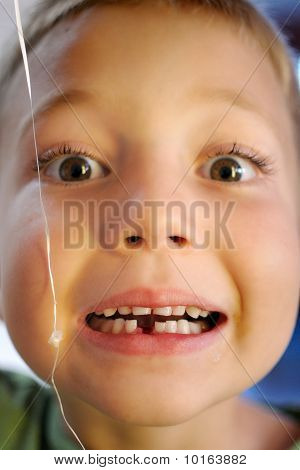 Young Boy With a Lost Tooth