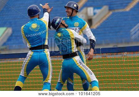 ST. PETERSBURG, RUSSIA - SEPTEMBER 9, 2015: Team Kazakhstan celebrate good result in competitions in combat deployment during XI World Championship in Fire and Rescue Sport