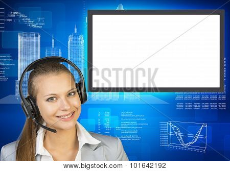 Smiling businesslady in earphones