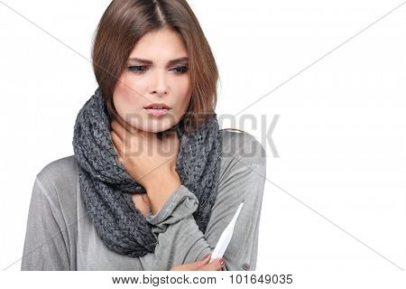 ill woman taking her temperature wile feeling sick and with fever, isolated on a white background poster