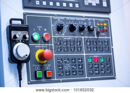 Switches on control panel of production machine