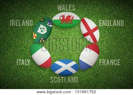 Six nations rugby balls against close up view of astro turf