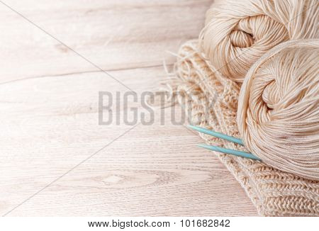 Balls Of Yarn And Knitting Needles