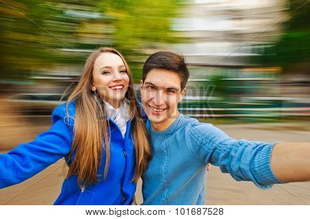 Young  merry couple autumn