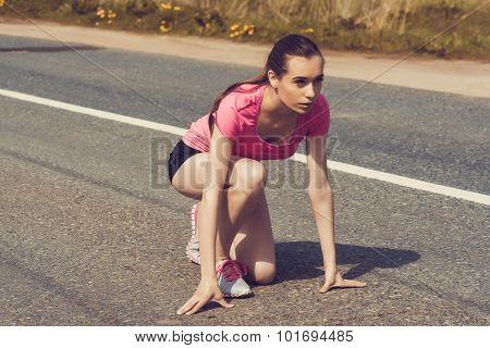 Female Sprinter Waiting For The Start On Road