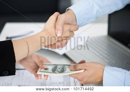 Woman And Man Handshake Close Up With The Money In The Other Hands