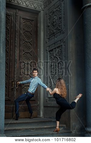 Man Holding Door Handle And  Girl To A Guy, Dance.