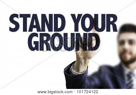 Business man pointing the text: Stand Your Ground