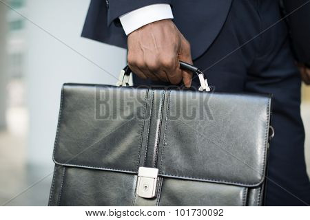 Detail of a businessman holding his briefcase