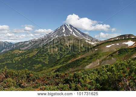 Beautiful volcanic landscape on Kamchatka Peninsula: picturesque view of Viliuchinsky Volcano at sunny day. Photo stratovolcano photographed with Vilyuchinsky pass (Russia Far East Kamchatka). poster