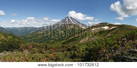 Panorama: beautiful mountain landscape on Kamchatka - picturesque view of Viliuchinsky Volcano at sunny day. Photo stratovolcano photographed with Vilyuchinsky pass (Far East Russian Federation). poster
