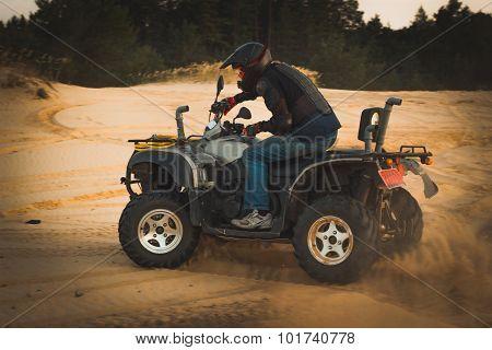 Racing ATV is sand.