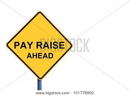 Yellow Roadsign With Pay Raise Ahead Message