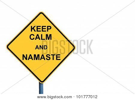 Yellow roadsign with KEEP CALM AND NAMASTE message isolated on white background poster