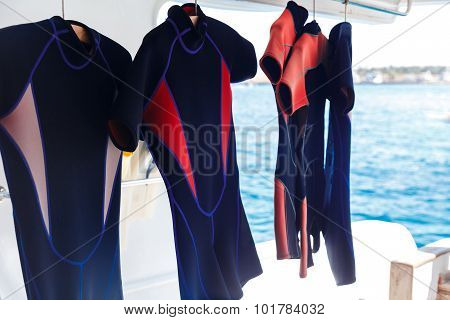 Hanging wetsuits