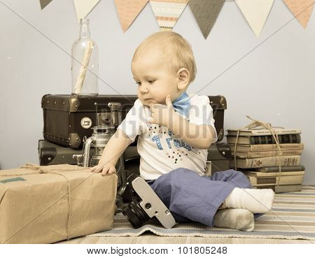 Old Photo Of Sad Baby Looking At Mail Package Indoors