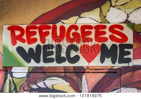 Refugees Welcome, graffiti sign