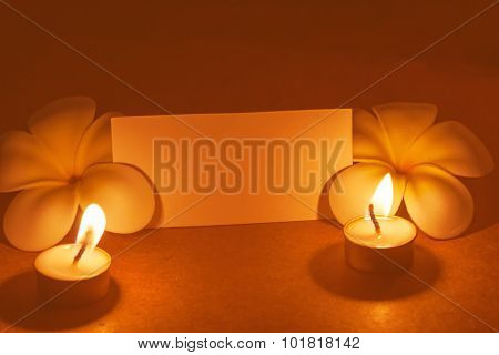 still life candle with flower and note paper,abstract background for pray or meditation caption.