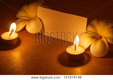 candle with flower and note paper.