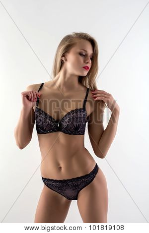 Erotica. Seductive woman in stylish lingerie