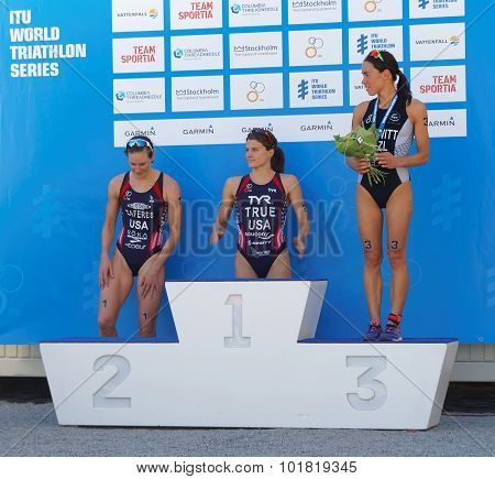 STOCKHOLM - AUG 22 2015: Sarah True Zaferes and Hewitt on the winner's stand in the Women's ITU World Triathlon series event August 22 2015 in Stockholm Sweden