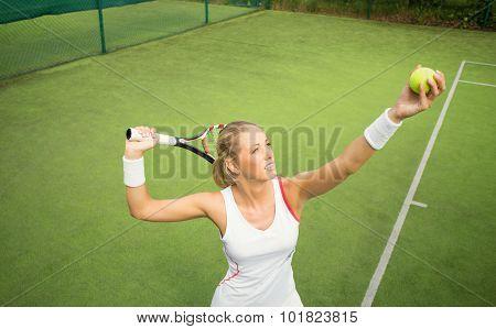 Woman practicing tennis