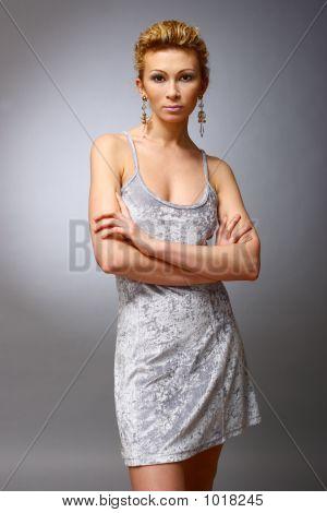 Girl Posing On Grey Background