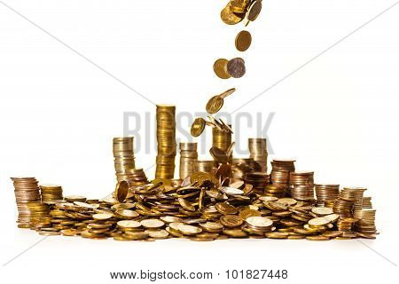 coins falling into a pile