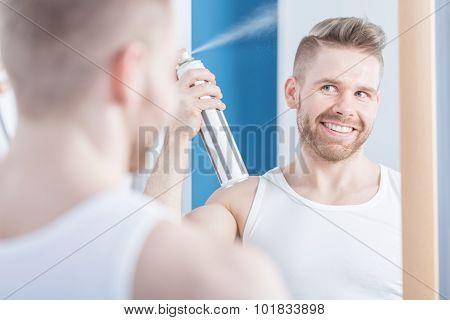 Stylish Male Spraying His Haircut