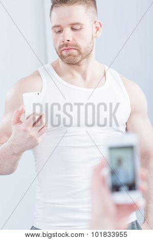 Handsome Muscular Man Taking Photo