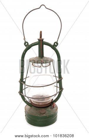 vintage green hurricane lamp on a white background studio cutout