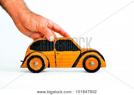 Man hands holds toy car on white background-copy space.Concept photo of car businesscar Insurance auto dealershipcar rental safe driving buying renting fuel service and repair costs.
