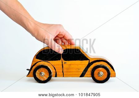 Woman hands holds toy car isolated on white background-copy space.Concept photo of car businesscar Insurance auto dealershipcar rental safe driving buying renting fuel service and repair costs