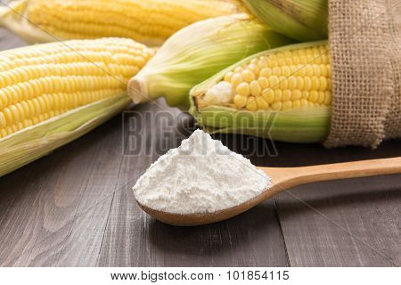 Corn Flour And Corn On Wooden Table