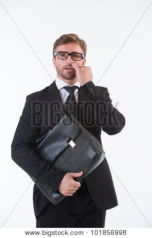 Businessman picking his nose