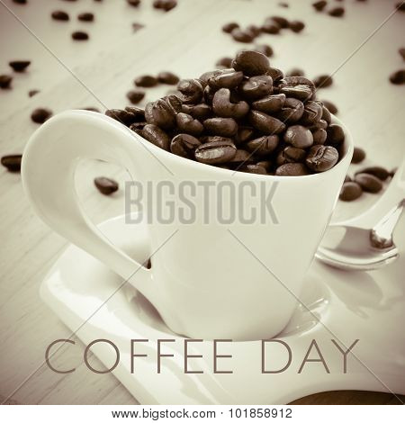 a cup full of roasted coffee beans and the text coffee day, in duotone