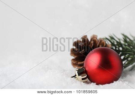 Christmas Border Background With Red Bauble And Foliage On Snow